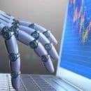 main de robot sur un clavier